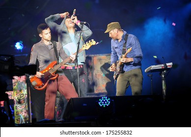 PRAGUE - SEPTEMBER 16: From left Guy Berryman, Chris Martin and Jon Buckland of Coldplay during performance in Prague, Czech republic, September 16, 2012.