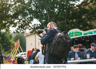 Prague, September 23, 2017: Celebrating the traditional German beer festival called Oktoberfest in the Czech Republic. The photographer takes photos for a story about the holiday in the news