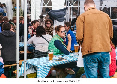 Prague, September 23, 2017: Celebrating the traditional German beer festival called Oktoberfest in the Czech Republic. People communicate with each other and drink fresh German beer.