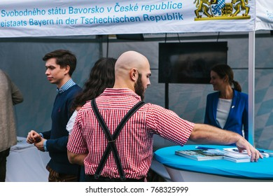 Prague, September 23, 2017: Celebrating the traditional German beer festival called Oktoberfest in the Czech Republic. The man takes booklets with information about the German Bavaria.