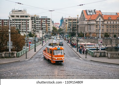 Prague, September 24, 2017: A special repair tram to support other trams in case of a breakdown or accident rides around the city. Nearby people walk on the pedestrian side of the road