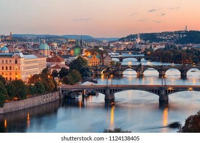 Prague skyline and bridge over river in Czech Republic.