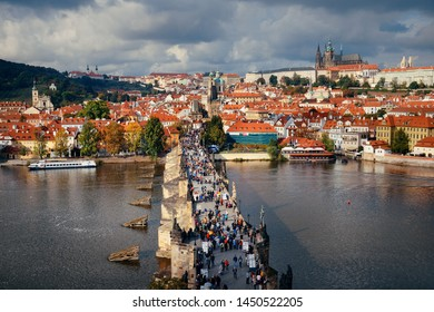 Prague skyline and bridge over river in Czech Republic.