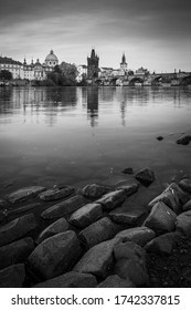 Prague skyline and bridge over river in black and white. Czech R