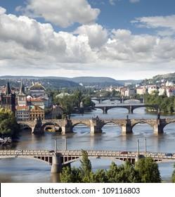Prague - skyline with Vltava River bridges, Old Town towers, Smichov Quarter and Charles Bridge, Czech Republic