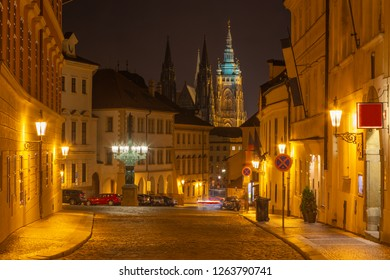 Prague - The St. Vitus cathedral and the Loretánská street at night.