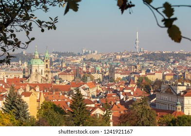 Prague - The Town with the St. Nicholas church and Charles bridge in evening light.