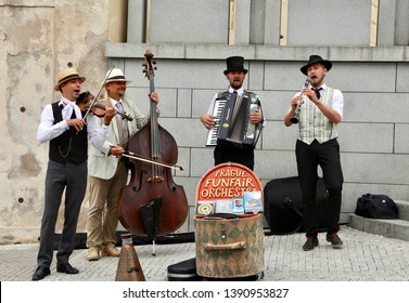 Prague/Chech-august 25 2018:  Quartet of Musicians playing musical instruments for tourists on the street in Prague