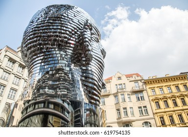 PRAGUE,CZECH REPUBLIC–APRIL 9, 2017: A Metal moving statue Metalmorphosis of writer Franz Kafka by Czech sculptor David Cerny.The statue stands at the Quadrio shopping centre and it is 11 meters high.