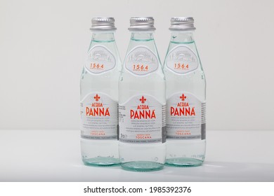 Prague,Czech Republic -  12 April, 2021: Three Glasses bottle of Acqua Panna Toscana mineral still healthy water.Acqua Panna is an Italian brand of bottled water and one of the world's largest bottle