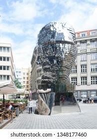 Prague/Czech Republic - August 12th, 2017: The 'Head of Franz Kafka', an outdoor kinetic sculpture by David Černý depicting Bohemian German-language writer Franz Kafka.