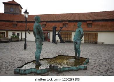 Prague/Czech Republic - December 31 / 2018 : Statues of two man in front of Kafka Museum