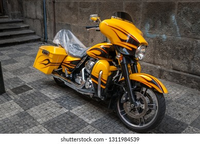 Prague/Czech Republic- February 5, 2019 Dark yellow touring motorcycle Harley Davidson Electra Glide Ultra Classic parked on the street.
