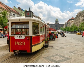 PRAGUE,CZECH REPUBLIC - MAY 9, 2013: A street restaurant made of a n old tram that located at Wenceslas Square with Prague National Museum on the background.