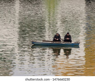 PRAGUE/CZECH REPUBLIC- NOVEMBER 3 2018: Two Men are Fishing on a Boat