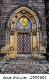 Prague,Czech Republic - September 25, 2018: Side entrance door of St. Peter and Paul church in Vysehrad, Prague, Czech Republic