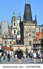 Prague,Czech republic,06 18 2018,tourists on Charles bridge enjoying the old district of Mala Strana architecture buildings.