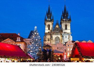 PRAGUE,CZECH REPUBLIC-JAN 05, 2013: Prague Christmas market on Old Town Square with gothic Tyne cathedral
