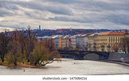 Prague,Czech Republic-November 18, 2017: View of Vitava river and historical center of Prague city in Eastern Europe. Famous Charles Bridge and historical buildings are attractive for tourists.
