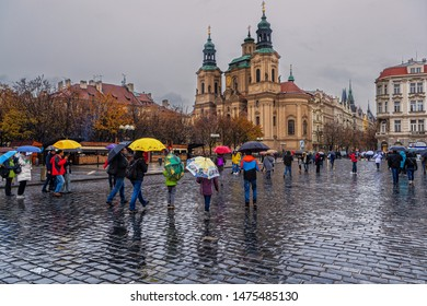 Prague,Czech Republic-November 19, 2016: Tourists walk in the old town of Prague in a rainy day.