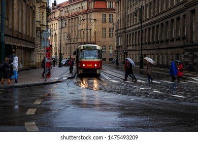 Prague,Czech Republic-November 19, 2016: Trolleybus in the streets of Prague city in a rainy day and the pedestrians cross the street.