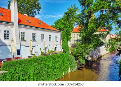 Prague's Mala Strana(Lesser Town of Prague). �¡ozy streets with cafes on the river side.Czech Republic.