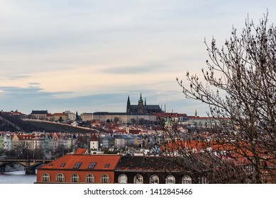 Praha city panorama with Prazsky hrad castle from Vysehrad in Czech republic during early spring evening with blue sky and clouds