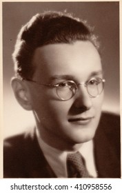 PRAHA (PRAGUE), THE CZECHOSLOVAK SOCIALIST REPUBLIC - CIRCA 1950S: The vintage photo shows young man wears glasses. The photography was taken for A level (GCSE exam) occasion.