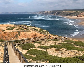 Praia da Bordeira and boardwalks forming part of the trail of tides or Pontal da Carrapateira walk in portugal