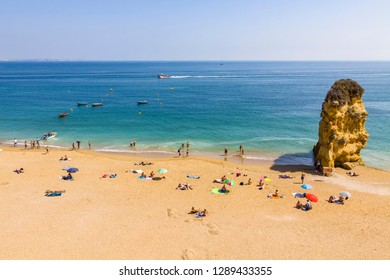 Praia da Dona Ana beach, Lagos, Algarve region, Portugal. Praia Dona Ana surrounded by steep colourful strata cliffs. One of the most picturesque beaches in Algarve. One of the best beach of Portugal
