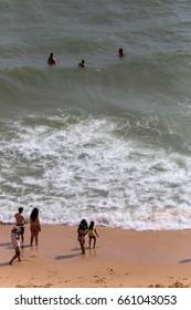 PRAIA DA MARINHA, PORTUGAL - APRIL 24, 2017: People at the famous beach of Praia da Marinha in Lagoa. This beach is a part of famous tourist region of Algarve.