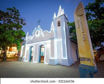 Praia do Forte, Bahia, Brazil - October 23: View of Sao Francisco Church illuminated at night in Praia do Forte, Bahia, Brazil.