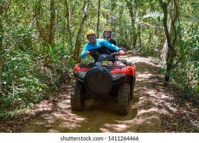 Praia do Forte, Brazil - 31 January 2019: people driving a quad on the forest near Praia do Forte in Brazil