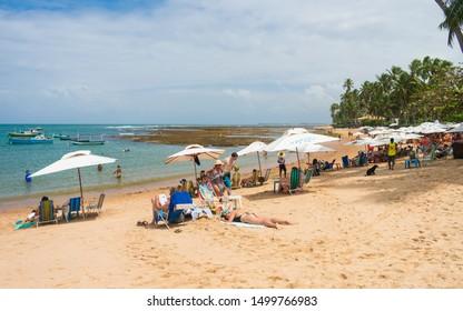 Praia do Forte, Brazil - Circa September 2019: People enjoying a sunny Sunday at Praia do Forte - popular beach near Salvador, Bahia