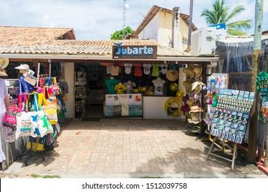 Praia do Forte, Brazil - Circa September 2019: Beach wear and souvenir shop at the main street of Praia do Forte, popular beach near Salvador, Bahia