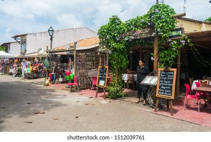 Praia do Forte, Brazil - Circa September 2019: Shops and restaurants at the main street of Praia do Forte, popular beach near Salvador, Bahia