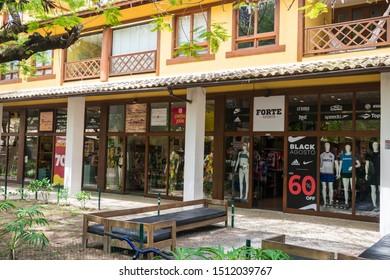 Praia do Forte, Brazil - Circa September 2019: Fancy brand shops at the main street of Praia do Forte, popular beach near Salvador, Bahia