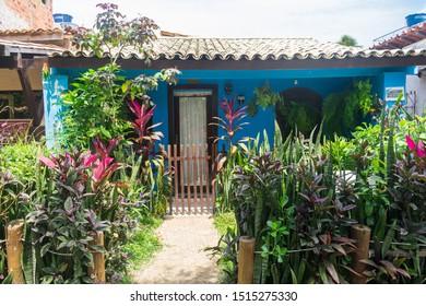 Praia do Forte, Brazil - Circa September 2019: Cute typical house with lush garden at Praia do Forte, popular beach resort near Salvador, Bahia