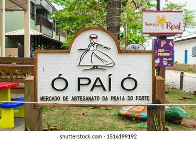 Praia do Forte, Brazil - Circa September 2019: Sign of the craft market at Praia do Forte, popular beach resort near Salvador