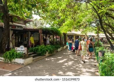 Praia do Forte, Brazil - Circa September 2019: Restaurants and shops at the main street of Praia do Forte, popular beach resort near Salvador, Bahia
