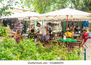 Praia do Forte, Brazil - Circa September 2019: Outdoor cafe at the main street of Praia do Forte, popular beach near Salvador, Bahia