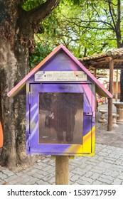 Praia do Forte, Brazil - Circa September 2019: Little free library stand at Praia do Forte, popular beach resort near Salvador, Bahia