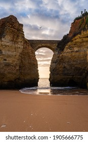 Praia dos estudantes beach with arch bridge in Lagos, Portugal