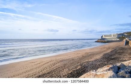 Praia Grande, Sintra, Portugal. View of Atlantic coastline - beach with big waves.