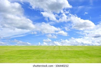Prairie and blue sky clouds.