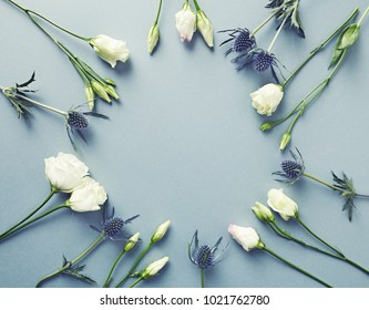 Prairie Gentian Flowers and Amethyst Sea Holly Flowers on paper background