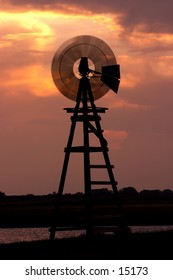 A prairie windmill spins in the wind