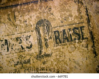 Praise.  Cover of an antique hymnal.