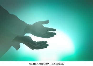 Praise and worship concept: Human open empty hand with palm up symbol for praise and worship over light from church background