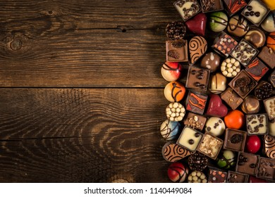 pralines on the wooden plank background